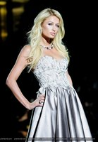 Paris Hilton is pelted with powder