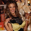 Alessandra Ambrosio exposed holds her yellow leopard bra