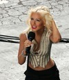 Christina Aguilera exposed her lace bra in a see through shirt