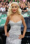 Christina Aguilera exposed her cleavage in a silver dress