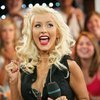 Christina Aguilera exposed her leopard bra down her blouse