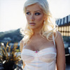 Christina Aguilera exposed her lingerie and cleavage in a photoshoot
