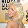 Christina Aguilera exposed her plunging cleavage in a sparkling dress