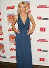 Daniela Pestova exposed her cleavage in a blue dress