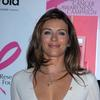 Elizabeth Hurley exposed her plunging cleavage in a white dress