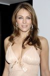 Elizabeth Hurley exposed her plunging cleavage