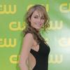 Erica Durance exposed her plunging cleavage in a black dress