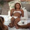 Eva Longoria exposed her pokies in a white bikini