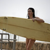 Evangeline Lilly exposed her bikini body behind a surfboard