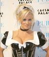 Jenny Mccarthy exposed her cleavage in a sexy maid halloween costume