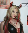 Jesse Capelli exposed her cleavage in a sexy latex halloween costume