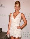 Jessica Simpson exposed her cleavage in a low cut dress