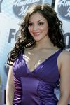 Katharine Mcphee exposed her cleavage in a purple dress