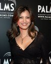 Kelly Hu exposed her black lace bra in a see through blouse