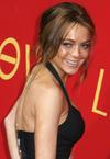 Lindsay Lohan exposed her cleavage down her blouse