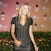 Maria Sharapova exposed her beige slip in a see through dress