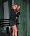 Mariah Carey exposed her cleavage in a black dress