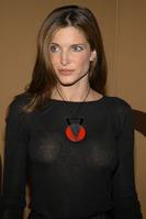 Stephanie Seymour exposed her beige bra in a see through dress