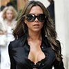 Victoria Beckham exposed her lacy black bra under her blouse