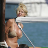 Victoria Silvstedt exposed her butt in a gold bikini